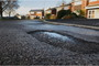 Pothole plea to resurface road and pavement in 'forgotten'...